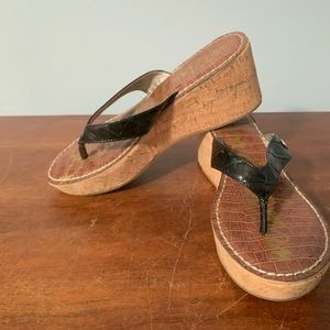 Black flip flops with cork wedge sole